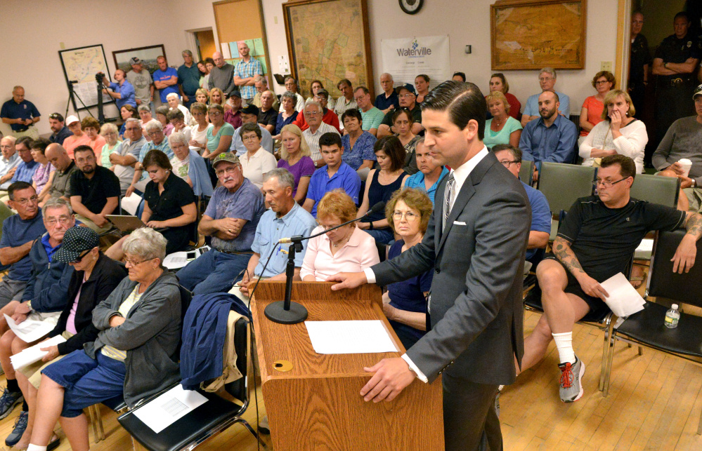 Waterville Mayor Nick Isgro addresses the city council from the public microphone to urge a vote to overturn his budget veto during a budget meeting in the city chambers at The Center in downtown Waterville on Tuesday.