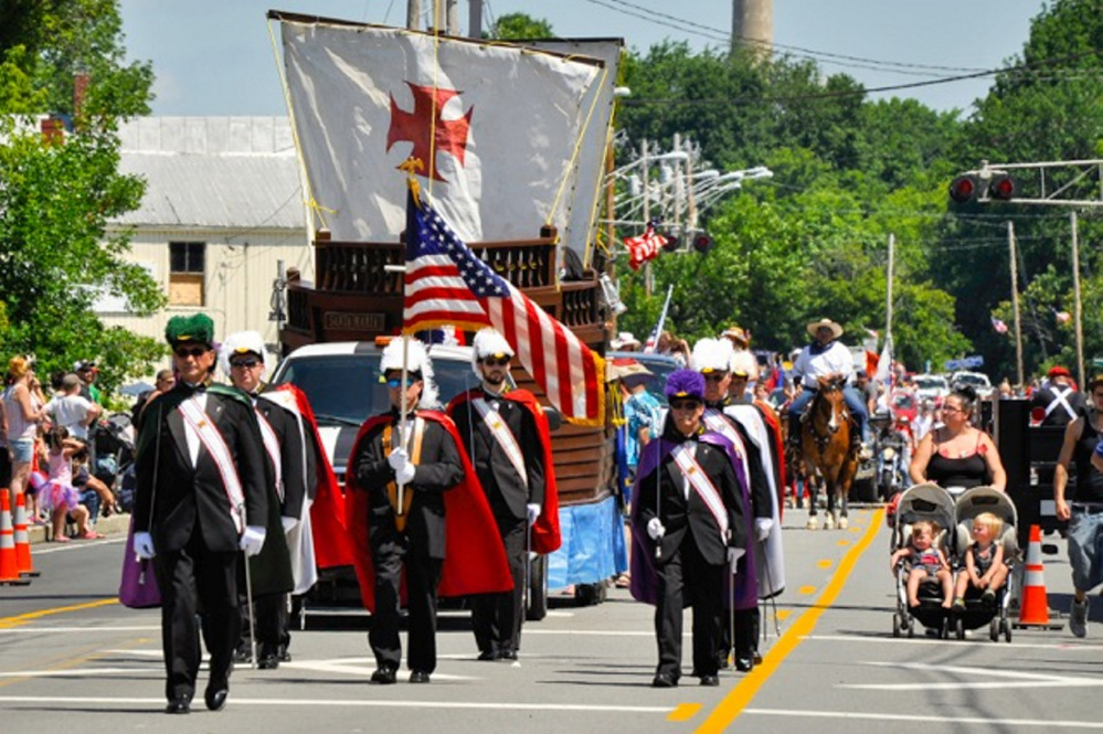 The Knights of Columbus march in the Winslow Family 4th of July parade earlier this month. Organizers of the event are looking for a new town to hold the event in.