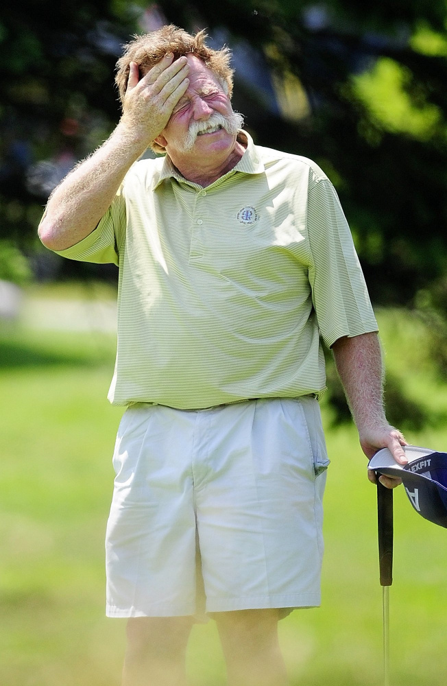 Mark Plummer mops his brows after finishing the first nine holes on the second day of a Charlie's Maine Open Championship at the Augusta Country Club.
