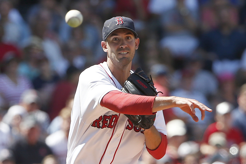 Boston's Rick Porcello throws to first base on the groundout by Minnesota's Eduardo Nunez during the fifth inning Sunday in Boston. Porcello allowed five runs on six hits while striking out eight and walking one.