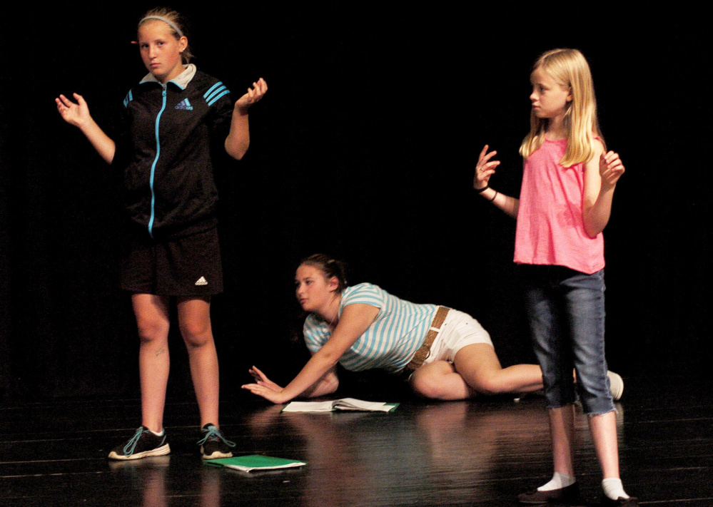 Children rehearse last week during a Farmington Children's Summer Theater Camp in Farmington. From left are Emma White, Iliana Marquez and Lydia Schofield. The group performs this Friday and Saturday.
