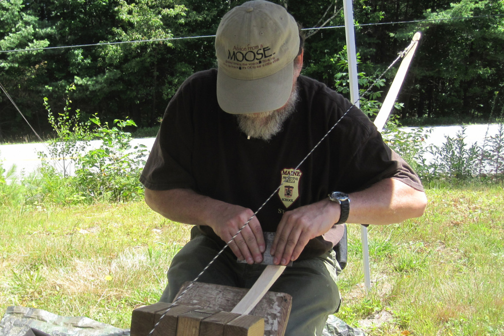 Will Sampson demonstrates how to build a bow.