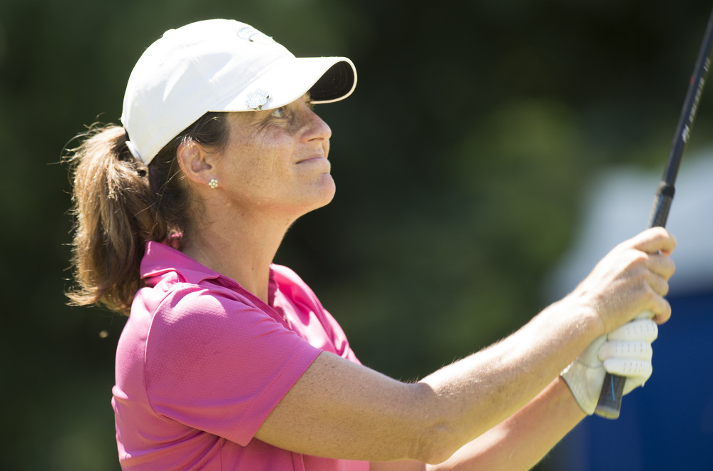 Staci Creech watches her drive on the 6th hole Wednesday at Penobscot Valley Country Club in Orono. Creech won Maine Women's Amateur golf tournament for the second consecutive year. (Kevin Bennett Photo)