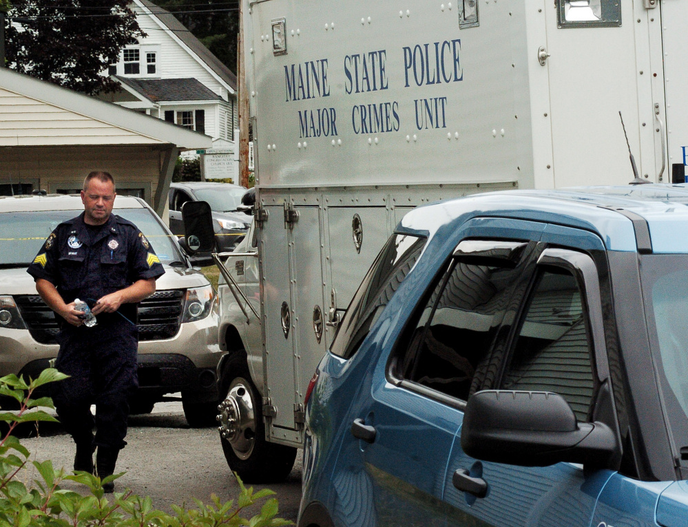 Maine State Police Sgt. Scott Bryant enters the department's Major Crimes Unit on Thursday near the scene of a possible home invasion that left one man dead and two injured in Rangeley.