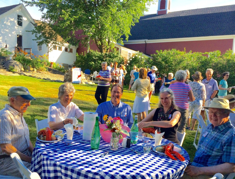 Marty Fox, left, and the Danielson family enjoy a traditional lobster bake during the Lincoln County Historical Association's Kermess on July 24 at the Foye-Sortwell Farm in Wiscasset. Yarmouth's Pan Fried Steel band added to the festive mood of the fundraiser to support LCHA's three historic sites, the Pownalborough Court House, Museum & Old Jail, and Chapman-Hall House.