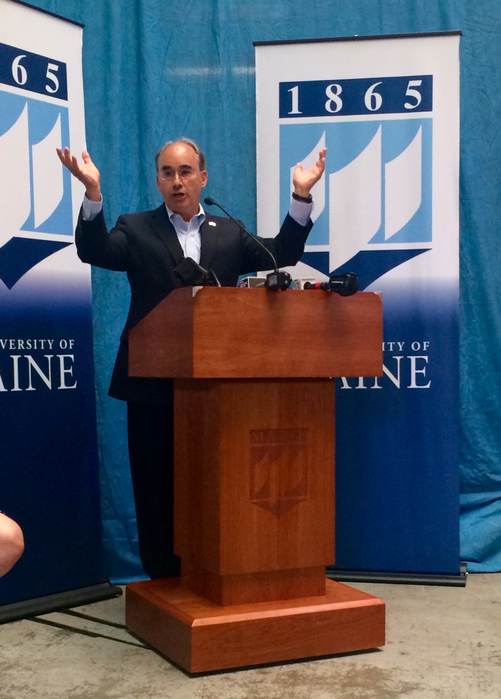 U.S. Rep. Bruce Poliquin talks about the high energy costs in Maine as a barrier to success for the state's paper industry at a news conference Friday at the University of Maine, in Orono.