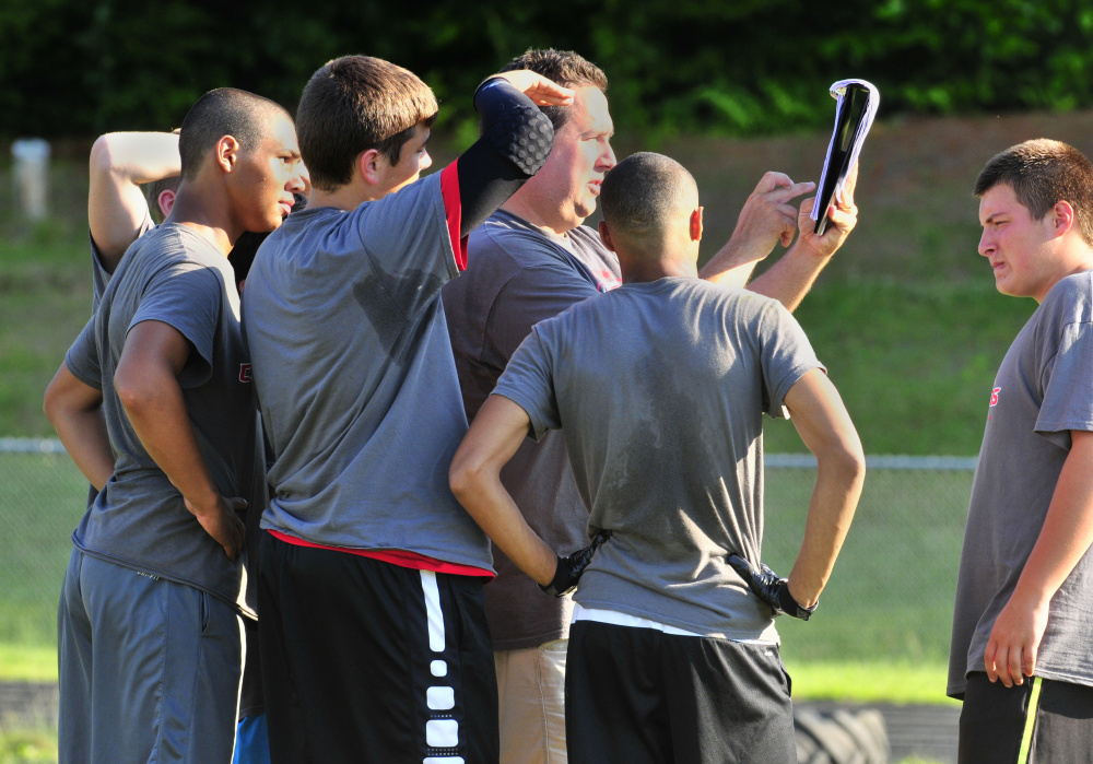 Cony football coach calls a play during a 7-on-7 game against Maranacook on Friday in Turner.