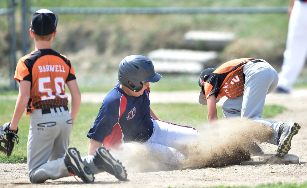 Freetown/Lakeville's Maddoxx Rosyski (8) slides safely into second base before Skowhegan's Brayden Saucier (2) can make the play during the 11-year-old Cal Ripken New England tournament Saturday at Carl Wright Complex in Skowhegan.