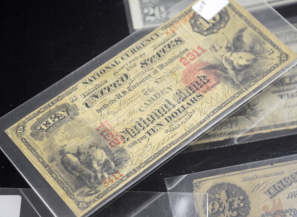 A 19th-century $10 bill issued by Camden National Bank, from the collection of Frank Trask, on Sunday at the Capital City Coin Show, held at the Elks Lodge in Augusta.