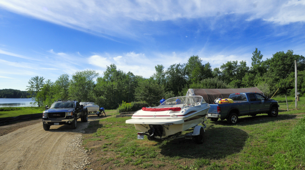 Employees work on boats Saturday at Beacon Boat Rental in Wayne.