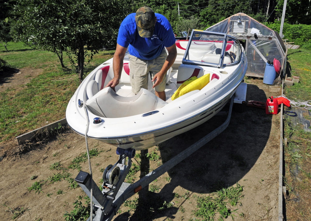 Gary Sawtelle cleans up a boat Saturday. It was returning from being rented out at Beacon Boat Rental in Wayne.