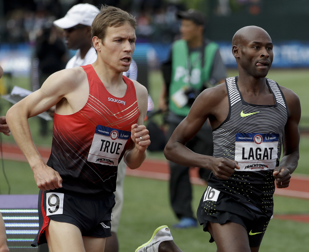 Ben True, left, races Bernard Legat during the men's 5,000 meters at the U.S. Olympic trials in Eugene, Ore. Lagat won and True was fifth. True will compete in the Beach to Beacon 10K in August.