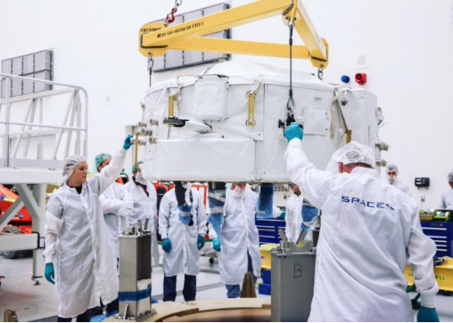 Photo shows the main payload on the SpaceX rocket that will be launched early Monday. SpaceX aims to carry another load of space station supplies for NASA, including a critical docking port needed by new U.S. crew capsules set to debut next year.
