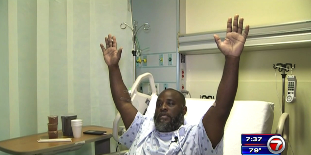 Charles Kinsey explains in an interview from his hospital bed in Miami how he was shot by police on Monday as he was trying to calm an autistic patient in the middle of the street. He said he had his hands in the air and repeatedly told the police that no one was armed.