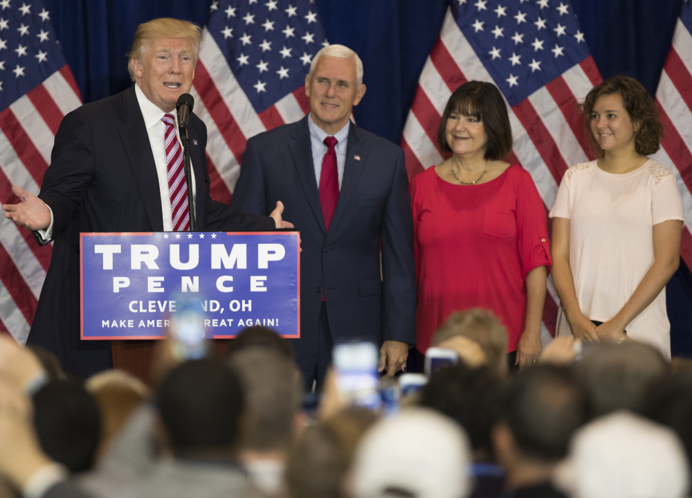 Republican presidential nominee Donald Trump speaks at a reception after the Republican National Convention on Friday in Cleveland. Listening are vice presidential running mate Gov. Mike Pence, R-Ind., Karen Pence, and Charlotte Pence.