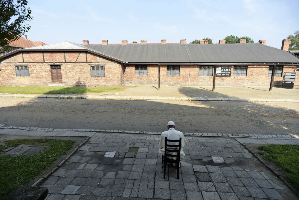 Pope Francis prays Friday at the Nazi German death camp of Auschwitz-Birkenau in Oswiecim, Poland, where Adolf Hitler's forces killed more than 1 million people, most of them Jews, during Worl War II.