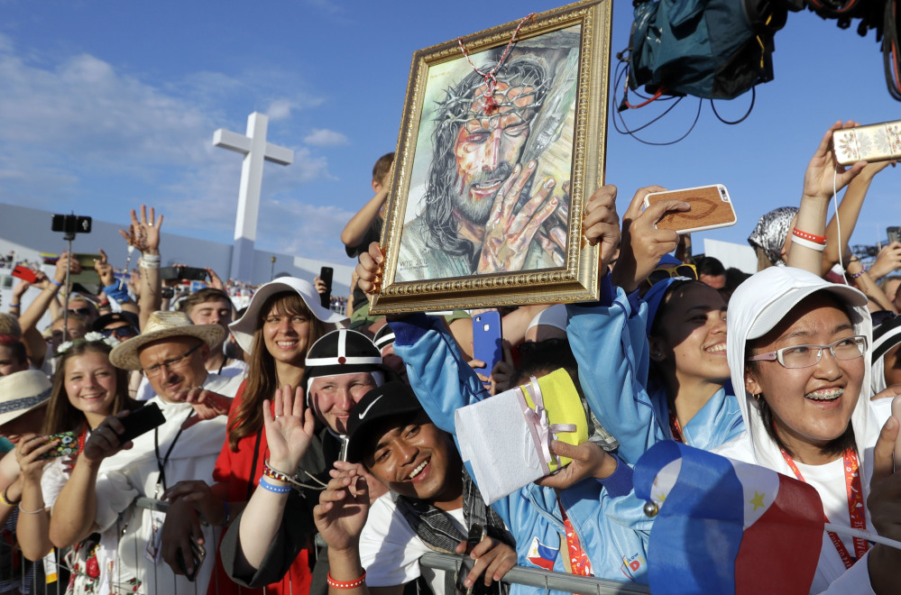 Faithful of all ages wait for Pope Francis to arrive for a prayer vigil on the occasion of the World Youth Days, in Campus Misericordiae in Brzegi Saturday.