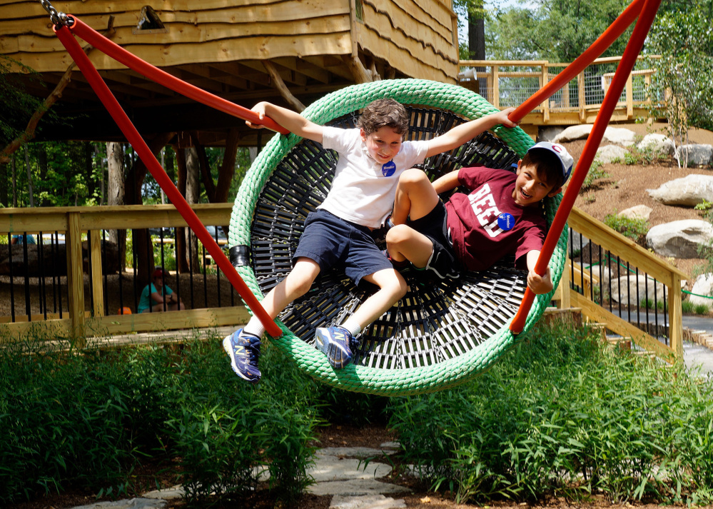 Zachary Abramovich, 7, and Reed Churchill, 6, swing on a new wicker swing at Discovery Museums in Acton, Mass.