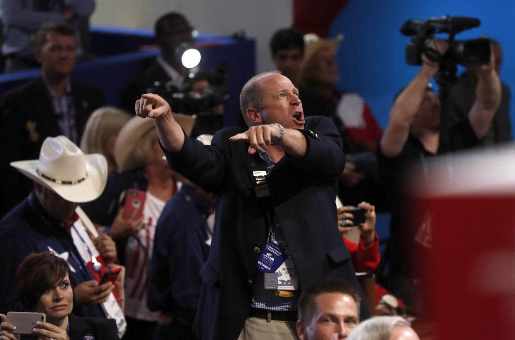 A delegate shouts as a call for a roll call vote on the rules goes out Monday, the opening day of the Republican National Convention in Cleveland.