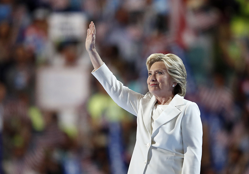 Democratic presidential nominee Hillary Clinton waves after taking the stage before her speech accepting the nomination.