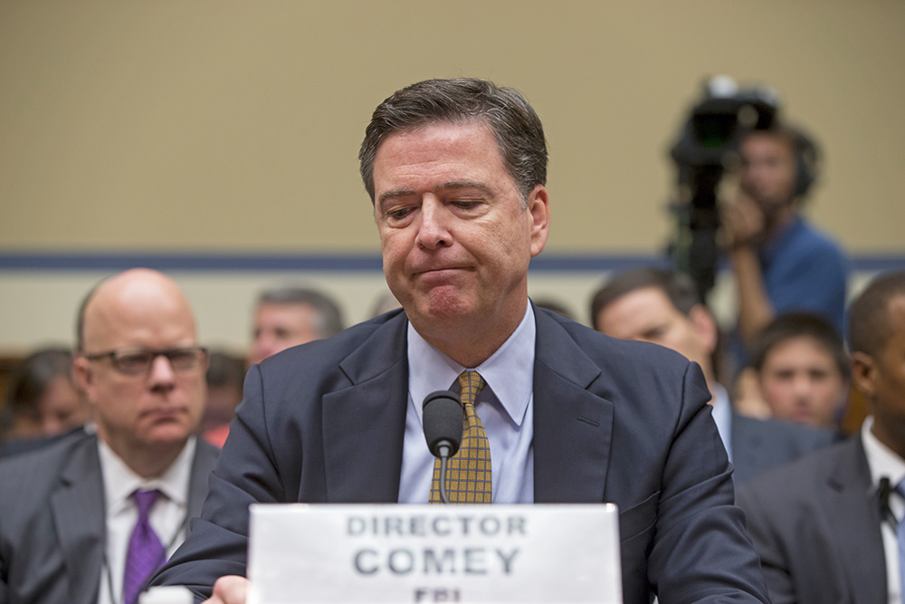 FBI Director James Comey  testifies on Capitol Hill on July 7, 2016, before the House Oversight Committee to explain his agency's recommendation to not prosecute Hillary Clinton over her private email setup during her time as secretary of state.