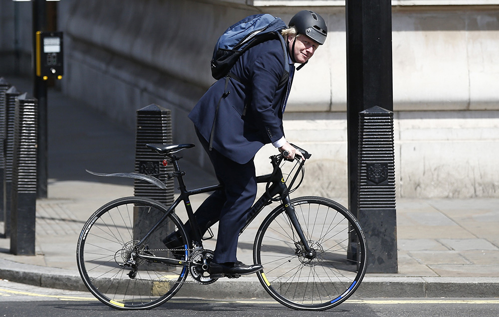 Boris Johnson rides his bike along Whitehall in London earlier this month. Instead of choosing a team player for the nation's top diplomatic post, Theresa May has chosen a politician who prides himself on being different.