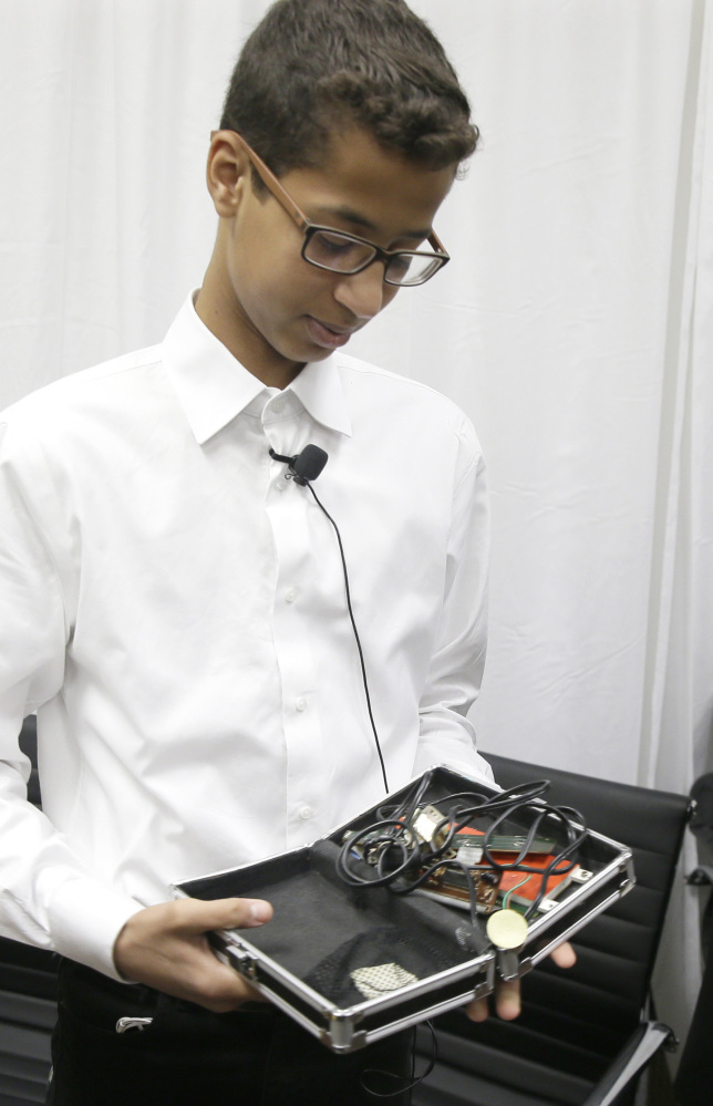 Ahmed Mohamed shows the clock he built in a plastic school pencil box to reporters after a news conference in Dallas on Monday.