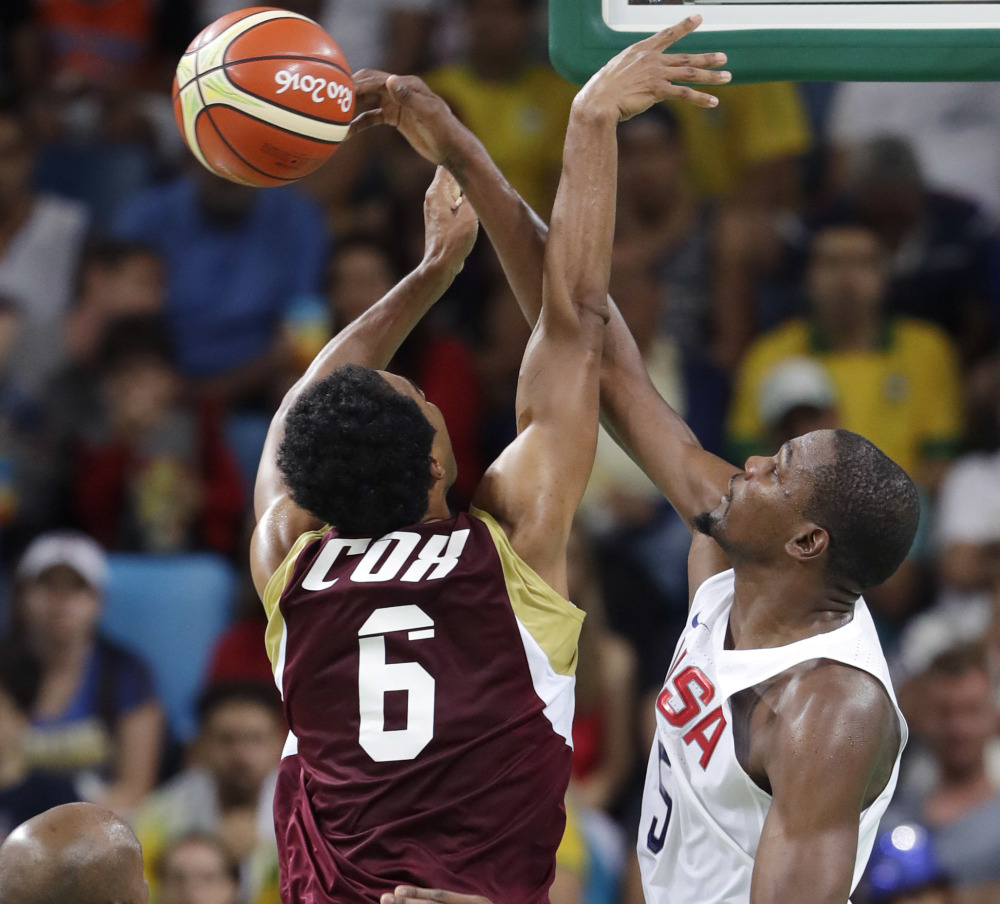 Kevin Durant of the United States, right, blocks a shot by Venezuela's John Cox during the U.S. men's team's 113-69 win Monday in Rio de Janeiro.