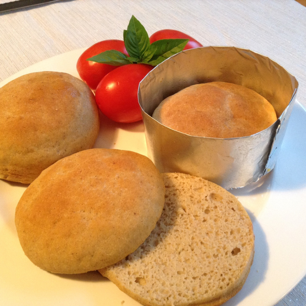 Homemade gluten-free hamburger buns featured a nicely textured, tender crumb. Creating a 4-inch aluminum foil collar or ring mold helps these buns keep a round form and rise higher.