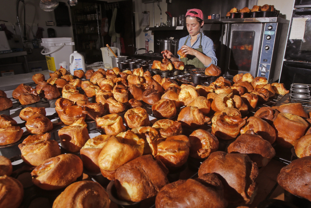 Jessica Stewart pulls popovers out of baking pans at the Common Good Soup Kitchen & Cafe.