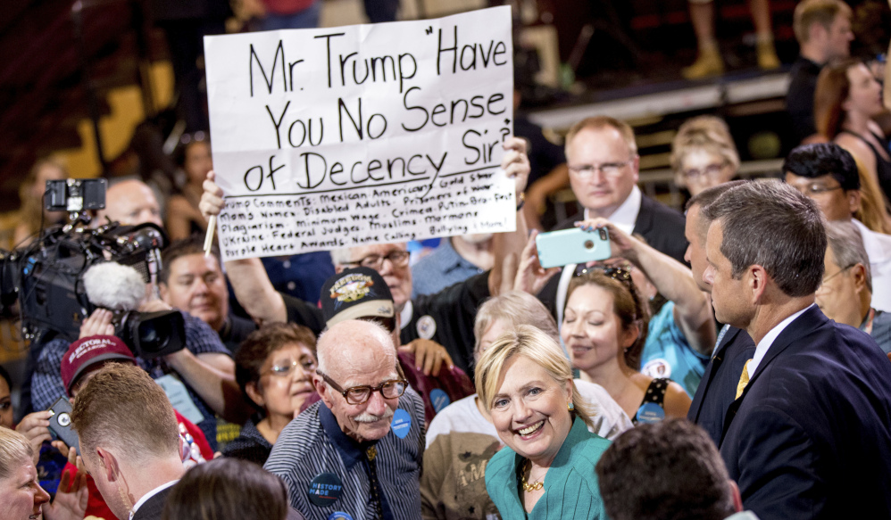 Democratic presidential nominee Hillary Clinton interacts with participants at a rally in Des Moines, Iowa, on Wednesday. She said Donald Trump's recent remarks to Second Amendment supporters show he lacks the temperament to be commander-in-chief.