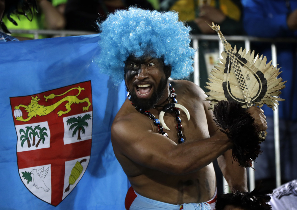 A Fiji fan celebrates his country's gold medal victory over Britain on Thursday in the men's rugby sevens. It was Fiji's first Olympic championship.