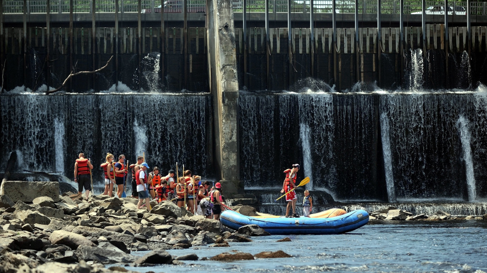 Rafters wait to board rafts operated by Moxie Outdoor Adventures for free rides down the Kennebec River in Skowhegan as part of a past River Fest. Free rides will be available Saturday at this year's event.