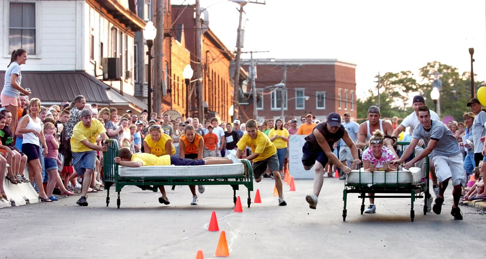 Two teams compete in a bed race down Russell Street in downtown Skowhegan during the Moonlite Madness festival during a past River Fest. This year's River Fest, with aims to promote the use of the Kennebec River and help raise money for the Run of the River water park, begins Tuesday and lasts through Saturday.