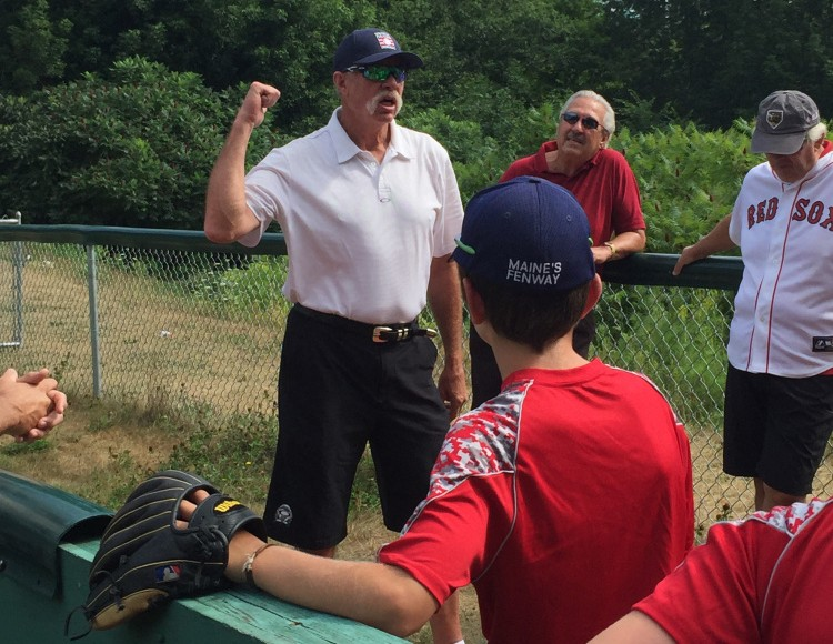 Goose Gossage talks with players during a clinic Monday at Harold Alfond Fenway Park in Oakland.