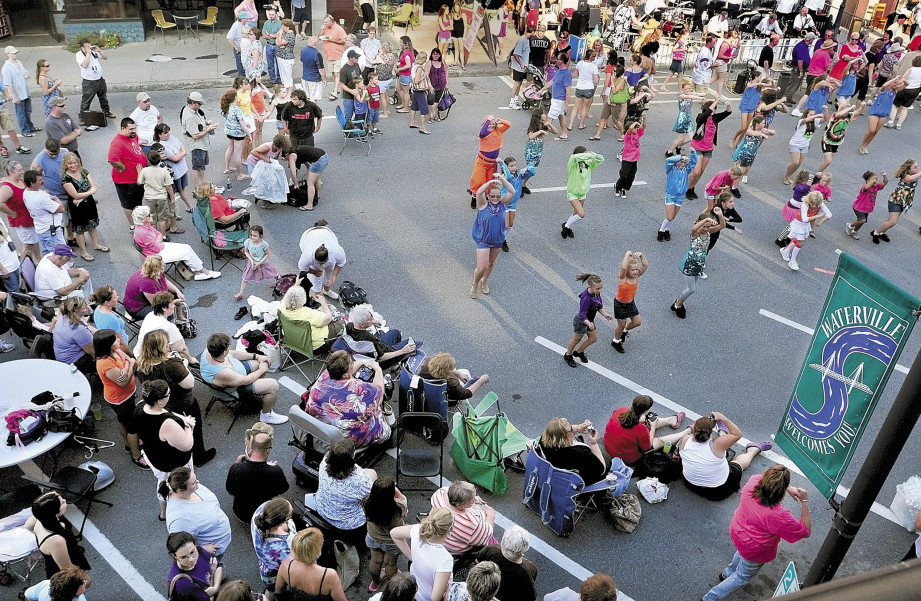 Crowds of people watch the Young American Dance Center perform on Main Street in Waterville during a Taste of Waterville event last year. This year's all-day event is scheduled for Wednesday.