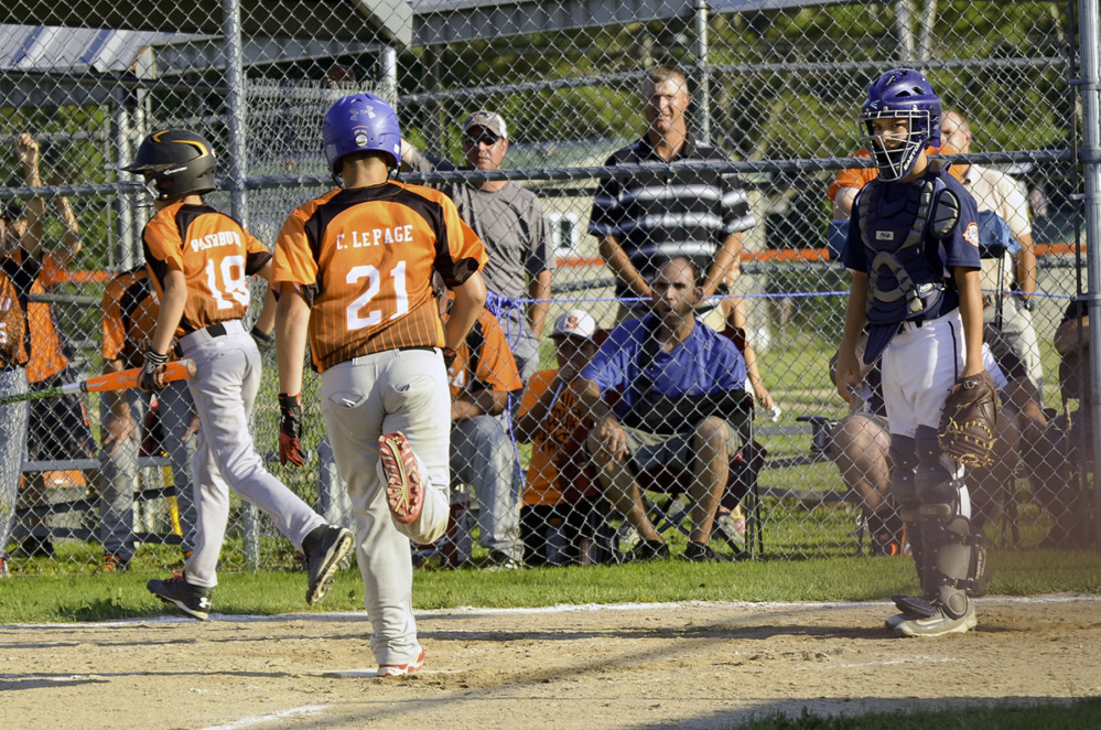 Oxford, Connecticut's catcher could only watch as Skowhegan baserunners Peyson Washburn and Collin LePage score in the third inning during Tuesday's elimination game in the Cal Ripken 11-Under baseball tournament in Skowhegan. Skowhegan stayed alive, winning 12-5.