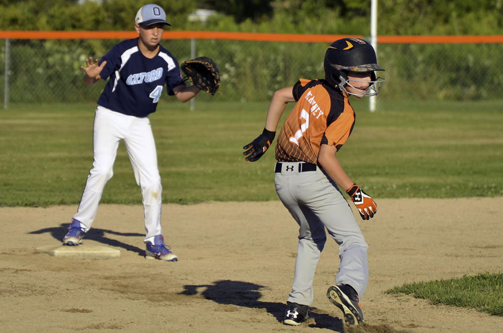 Skowhegan's Patrick McKenney is safe after being caught in a pickle during Tuesday's Cal Ripken 11-Under New England tournament game against Oxford, Connecticut, Tuesday. Skowhegan won, 12-5.