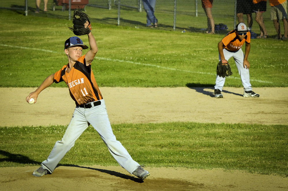 Simon Lewis manages to hold Skowhegan's lead as he takes over as relief pitcher in Tuesday's Cal Ripken 11-Under New England tournament game.