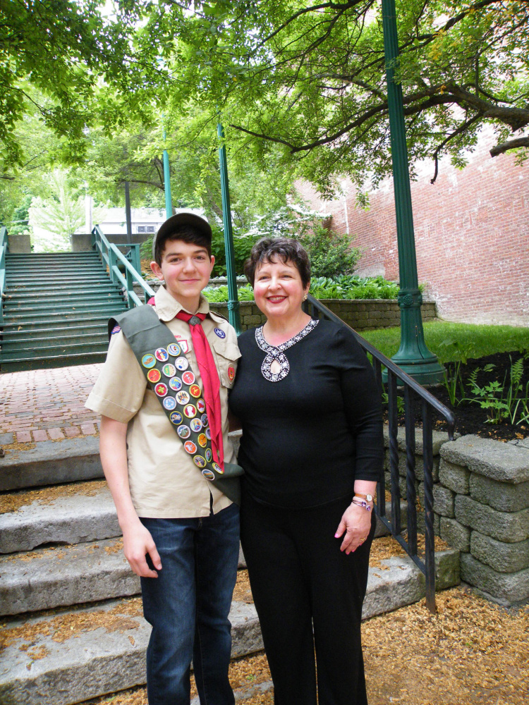 Aaron Jacob Henry Montell of Gardiner Boy Scout Troop 672, sponsored by Christ Church Episcopal, shared an Eagle Court of Honor with his cousin, Garrett Parker Brown, also of Troop 672, on June 5 in the old grand theater on the third floor of Johnson Hall in Gardiner. From left are Eagle Scout Aaron Montell with mother Susan Montell.