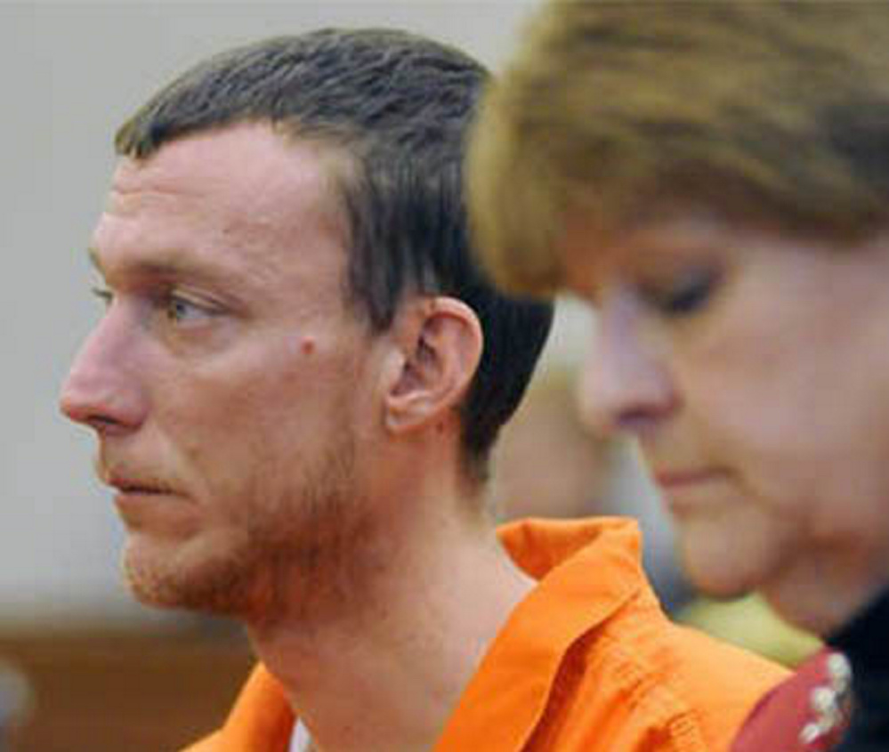 Mark Halle, 33, of Waterville, listens during his bail hearing in February with his attorney, Pamela Ames, in the Capital Judicial Center in Augusta.