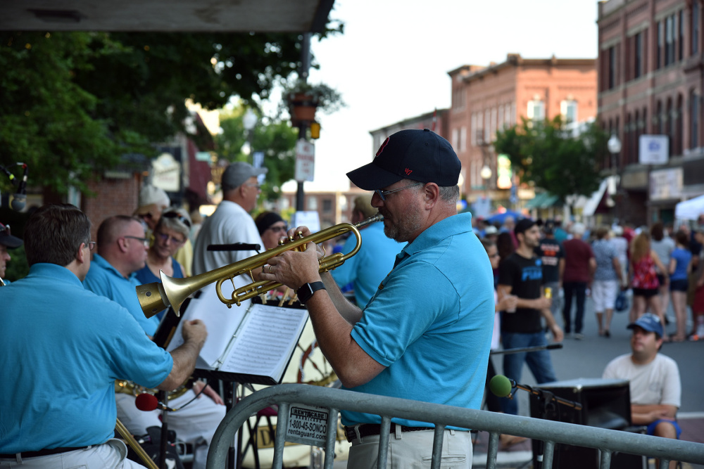 Andy Forester of Oakland, a member of the Downeast Quintet, warms up before playing Wednesday night as part of Taste of Waterville in downtown Waterville.