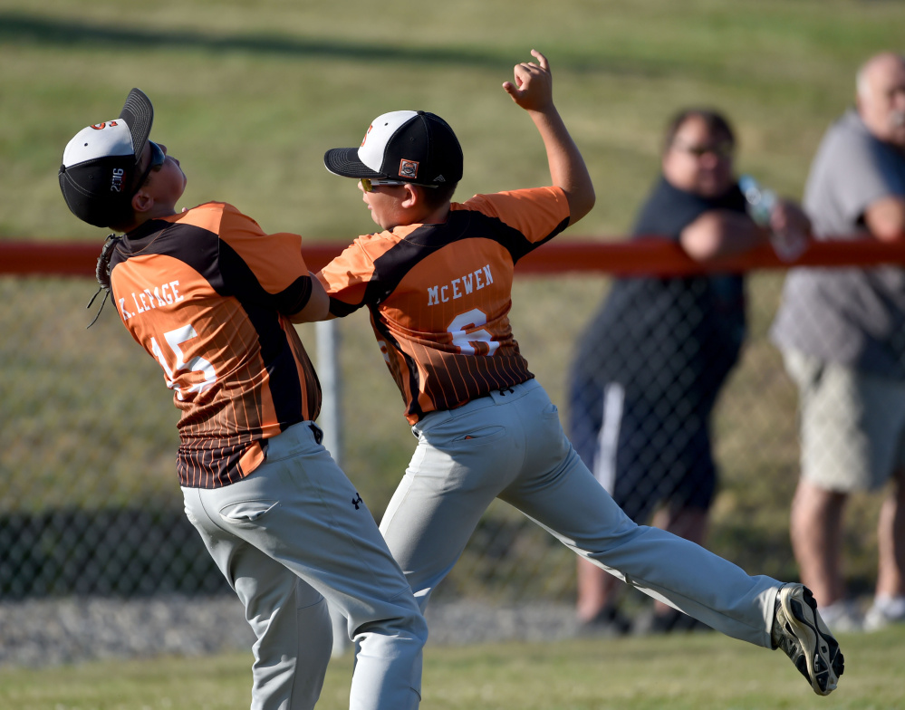 Skowhegan second baseman Hunter McEwen (6) collides with right fielder Kyle LePage (15) as he makes the catch against Marlboro, Massachusetts in the 11U Cal Ripken New England tournament Wednesday at the Carl Wright Complex in Skowhegan.