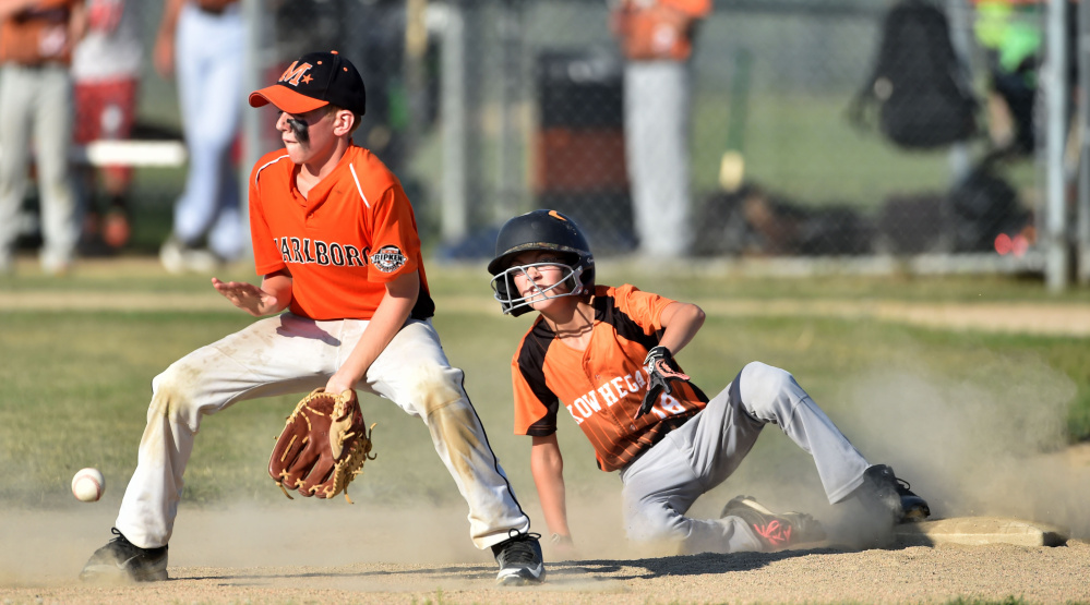 Skowhegan's Payson Washburn (18) slides into second base before Marlboro, Massachusetts second baseman Austin Hunt can make the tag in the 11U Cal Ripken New England tournament Wednesday at the Carl Wright Complex in Skowhegan.