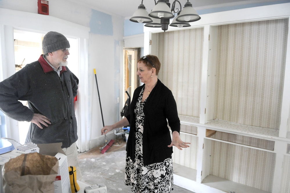 Betsy Ross House of Hope board president Charles McGillicuddy and executive director Martha Everatt St. Pierre discuss construction at 8 Summer St. in Augusta in this May file photo. The building is being converted into a shelter and transitional housing for female veterans.