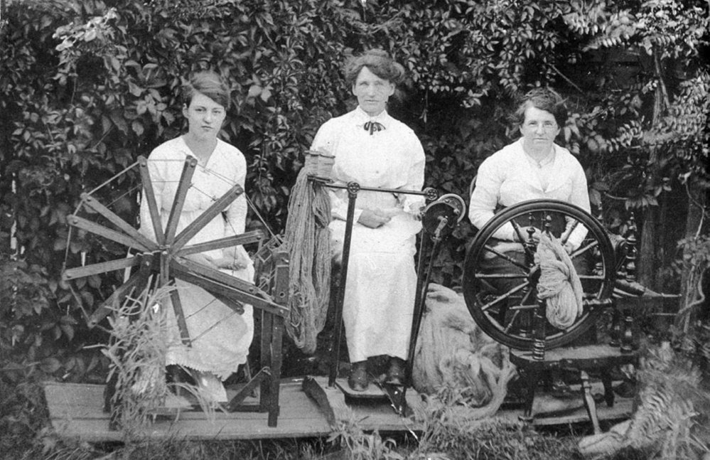 Spinners spinning wool into yarn for the Knitting Brigades of WWI.