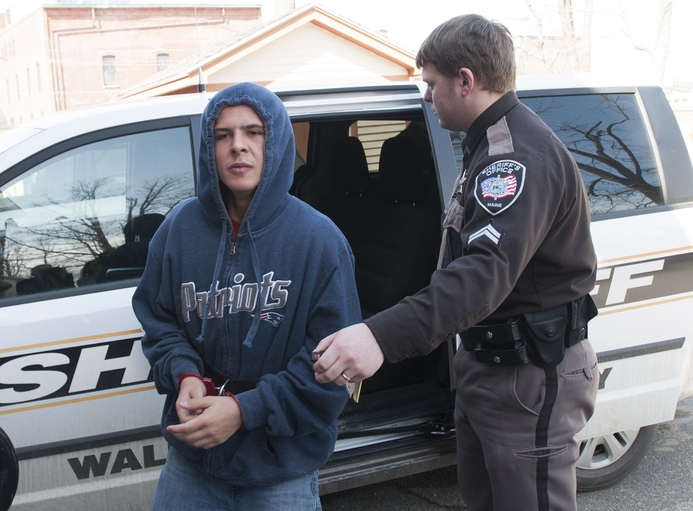 Colby Hodgdon is brought to Waldo County District Court in Belfast on April 3, 2015, to face a charge of murder in connection with death of his father, Steven Hodgdon. Colby Hodgdon was sentenced on a charge of manslaughter Friday.