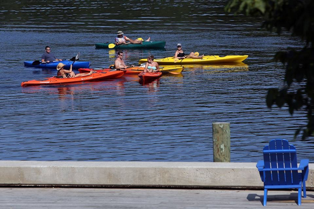 Kayakers enjoy last years Woodstock Revival from the Kennebec River.