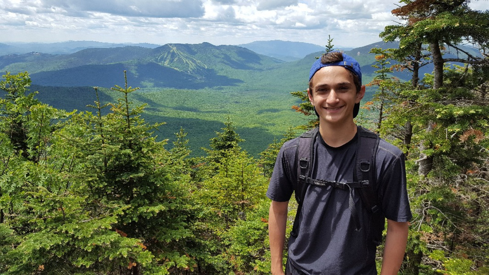 Anthony Romano, 15, of Hallowell, and his father, Jeff Romano, are hiking 271 miles to raise money for The Hearts for Ezra Foundation.