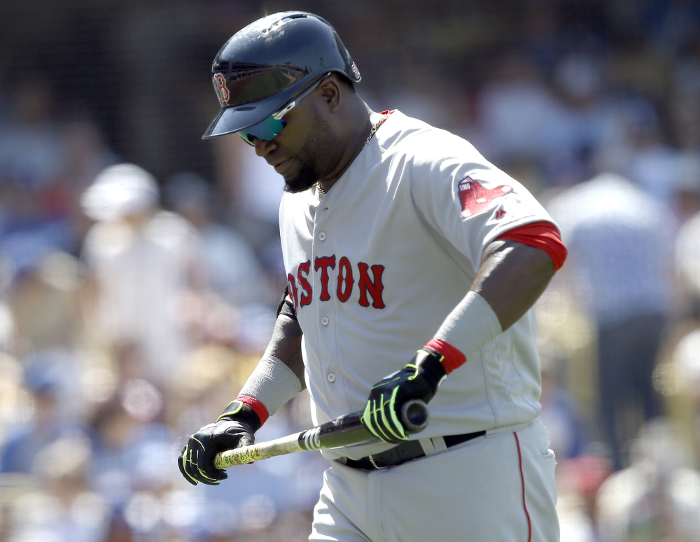 Boston slugger David Ortiz, right, walks back to the dugout after he strikes out against the Dodgers during the sixth inning Saturday.